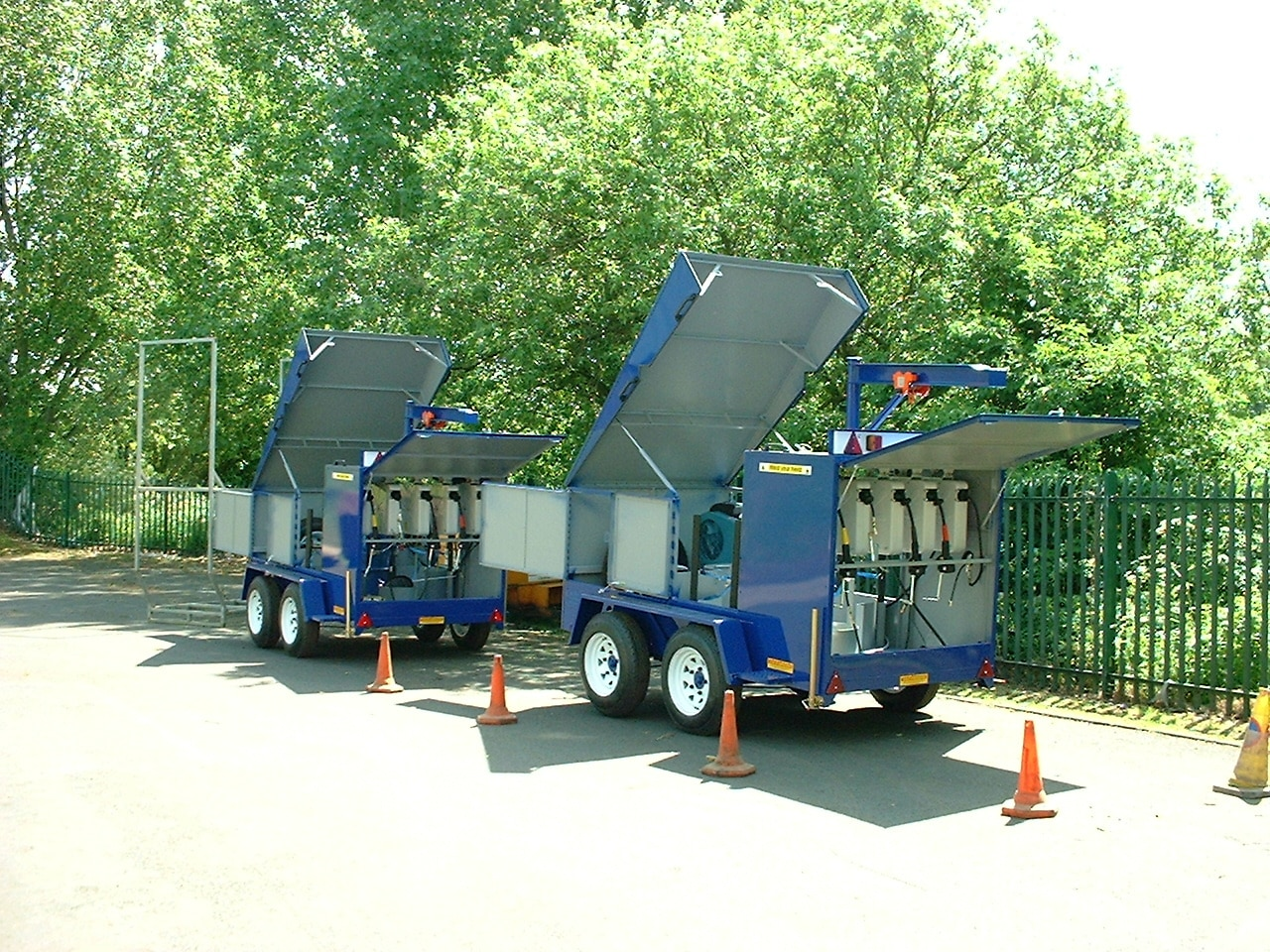 Two blue Jcb Lube Trailers